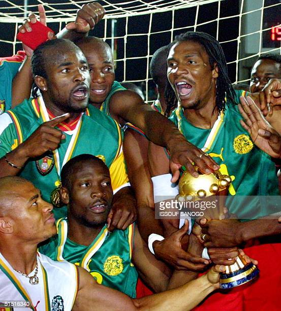 Cameroonian players jubilate with the cup after winning the final of the African Nations Cup against Senegal 10 February 2002 in Bamako Final score...