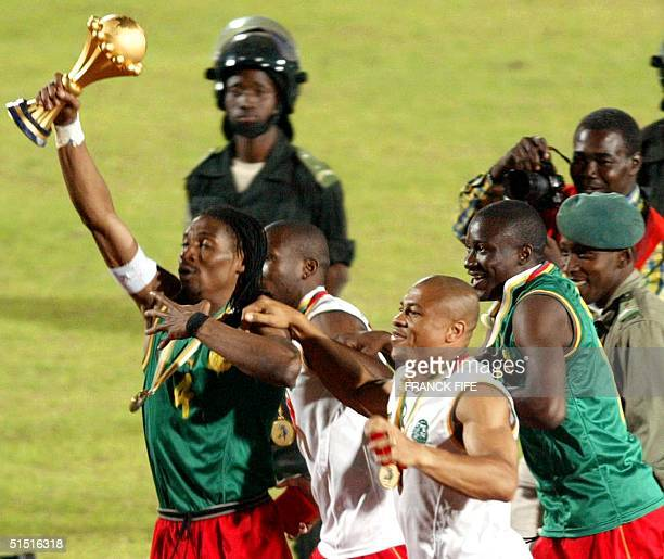 Cameroonian players with captain Rigobert Song holding the cup jubilate as they make a victory lap after winning the final of the African Nations Cup...