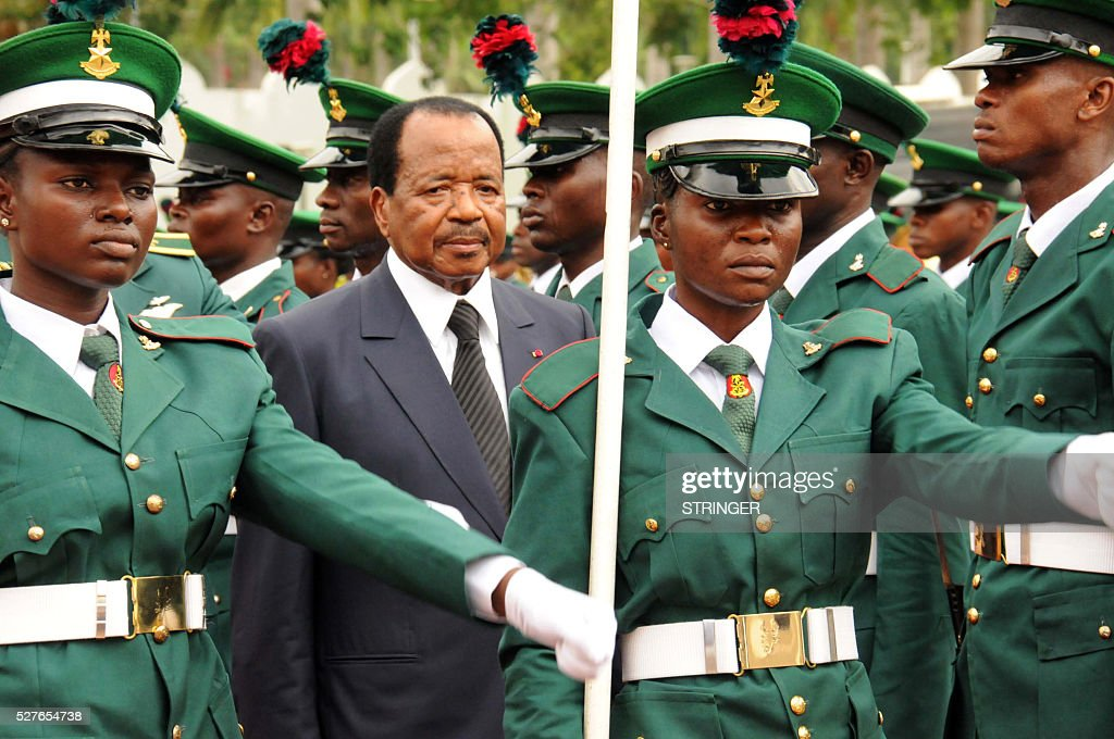 Cameroonian President Paul Biya inspects guards of honour at the Presidencial Villa in Abuja, on May 3, 2016. Cameroonian President Paul Biya arrived accompanied by wife Chantal and senior government officials for a two-day state visit to Nigeria. In a statement by the Special Adviser to President Buhari, both leaders and their officials will confer on issues of common interest to Nigeria and Cameroon, including ongoing bilateral and regional cooperation against terrorism, violent extremism and cross-border crimes. / AFP / STRINGER