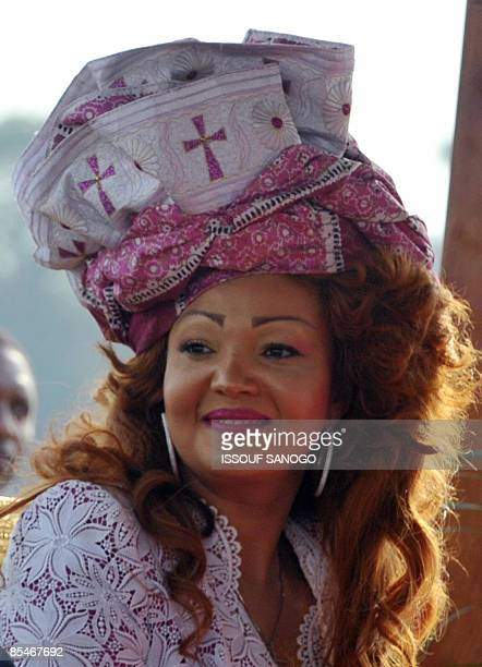 Cameroonian President's wife Chantal Biya welcomes Pope Benedict XVI during the welcoming ceremony at the airport in Yaounde on March 17 2009 Pope...
