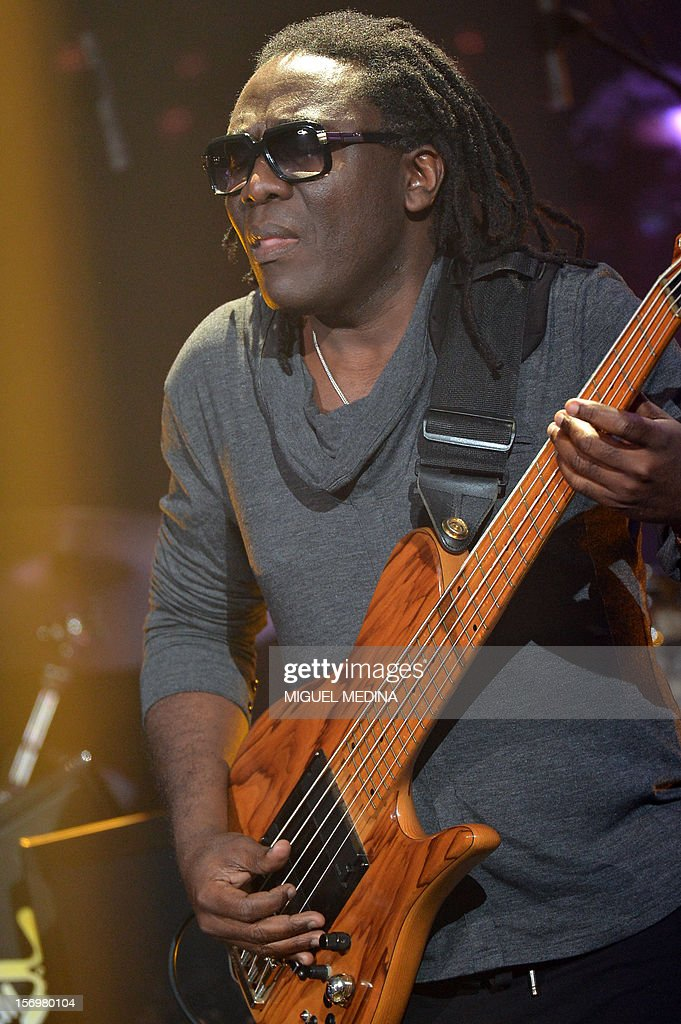 Cameroonian singer Richard Bona performs on stage after receiving 'the Grand Prix du Jazz' during the SACEM (Societe des auteurs, compositeurs et editeurs de musique) Grand Prix awards ceremony on November 26, 2012 at the Casino de Paris. Every year the SACEM Grand Prix awards identify favourites among creators from the music, entertainment and audiovisual worlds and the media. AFP PHOTO MIGUEL MEDINA