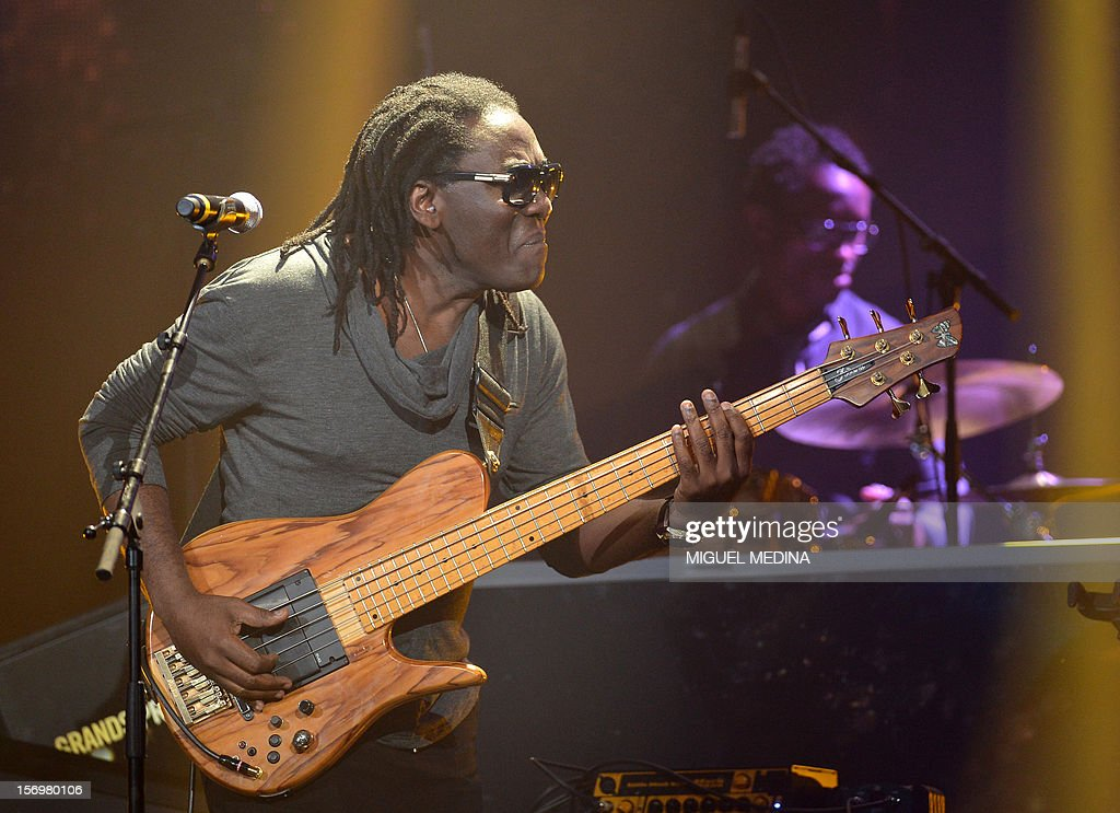Cameroonian singer Richard Bona performs on stage after receiving 'the Grand Prix du Jazz' during the SACEM (Societe des auteurs, compositeurs et editeurs de musique) Grand Prix awards ceremony on ...