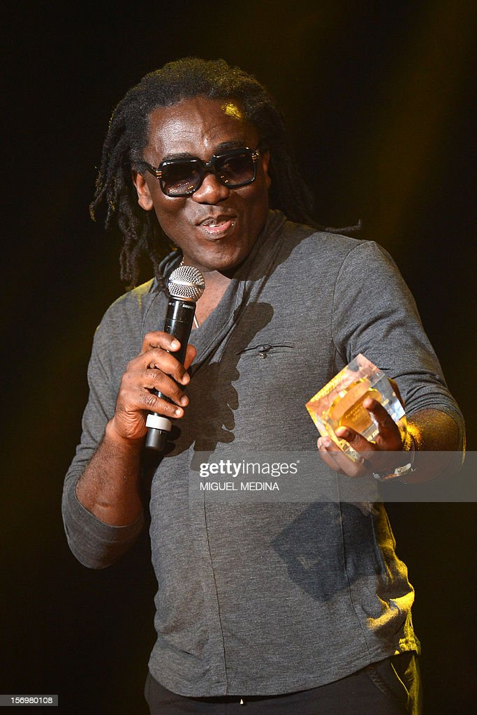 Cameroonian singer Richard Bona speaks after receiving 'the Grand Prix du Jazz' during the SACEM (Societe des auteurs, compositeurs et editeurs de musique) Grand Prix awards ceremony on November 26, 2012 at the Casino de Paris. Every year the SACEM Grand Prix awards identify favourites among creators from the music, entertainment and audiovisual worlds and the media. AFP PHOTO MIGUEL MEDINA