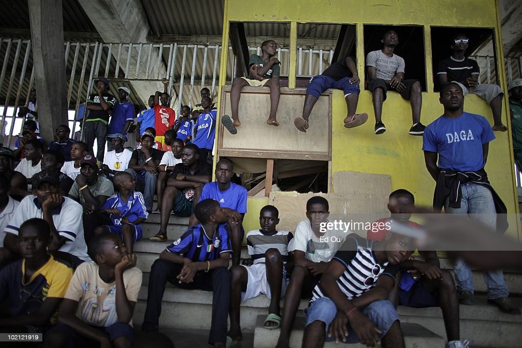Cameroonian soccer fans watches a league match in a stadium, May 22, 2010 in Douala, Cameroon.