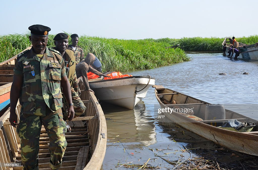 Cameroonian soldiers arrive in Darak as they patrol Lake Chad on March 1, 2013. Several security sources believe it is likely that members of the Islamist group Boko Haram, who have claimed responsibility in the kidnapping on February 19, 2013 of the French family in northern Cameroon and fled to Nigeria, then went north towards Lake Chad.