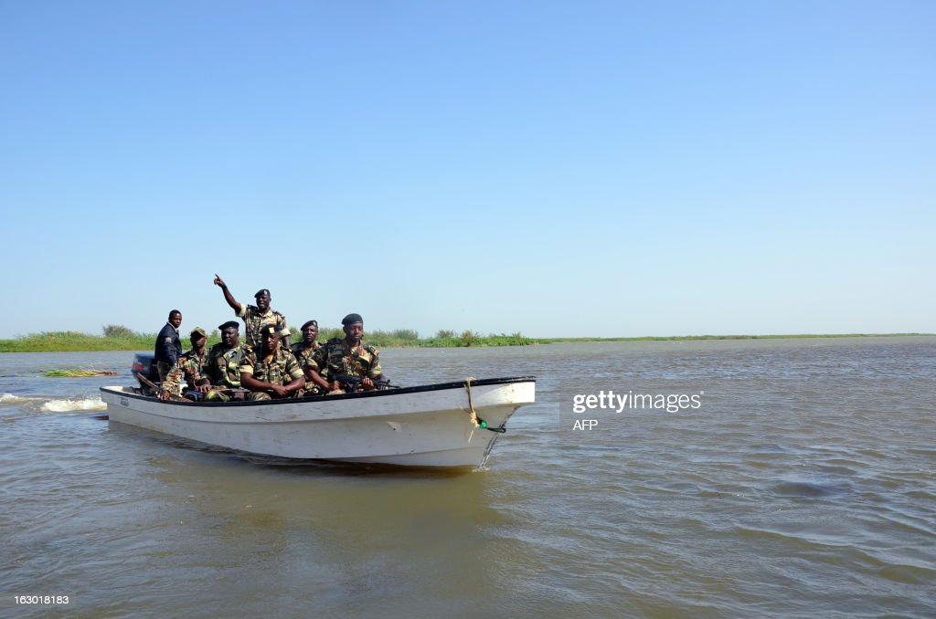 Cameroonian soldiers patrol Lake Chad on March 1, 2013 near Darak close to the Nigerian border. Several security sources believe it is likely that members of the Islamist group Boko Haram, who have claimed responsibility in the kidnapping on February 19, 2013 of the French family in northern Cameroon and fled to Nigeria, then went north towards Lake Chad.