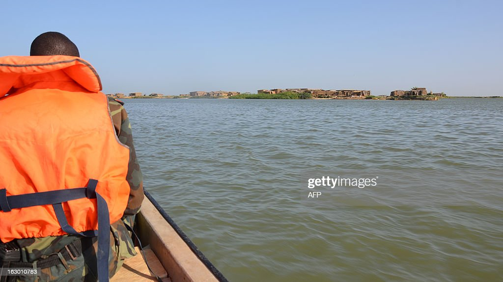 Cameroonian soldiers patrol on Lake Chad on March 1, 2013 in Blangoua. Several security sources believe it is likely that members of the Islamist group Boko Haram, who have claimed responsibility in the kidnapping on February 19, 2013 of the French family in northern Cameroon and fled to Nigeria, then went north towards Lake Chad.