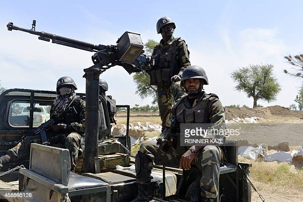Cameroonian soldiers patrol on November 12 2014 in Amchide northern Cameroon 1 km from Nigeria The city was raided by Islamists from Nigeria's Boko...
