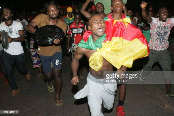 Cameroonians celebrate in the streets of Yaounde after Cameroon won the 2017 Africa Cup of Nations final football match against Egypt 21 on February...