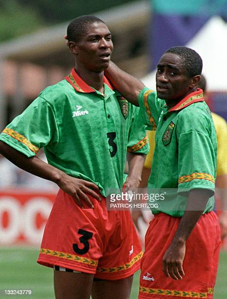 Cameroon's 17yearold defender Rigobert Song Bahanag is comforted by his teammate Louis Paul Mfede after receiving a red card and being sent off the...