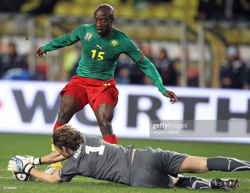 Cameroon s Achille Webo L vies with It