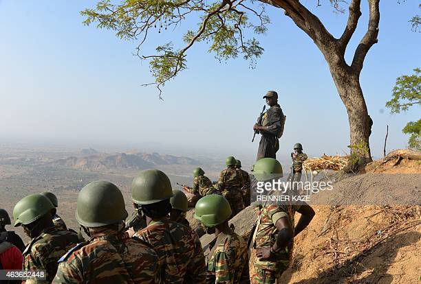 Cameroon's army forces patrol on February 16 2015 near the village of Mabass northern Cameroon Cameroon's army announced on February 17 2014 having...