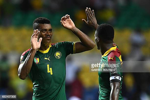Cameroon's defender Adolphe Teikeu celebrates with Cameroon's forward Benjamin Moukandjo at the end of the 2017 Africa Cup of Nations group A...