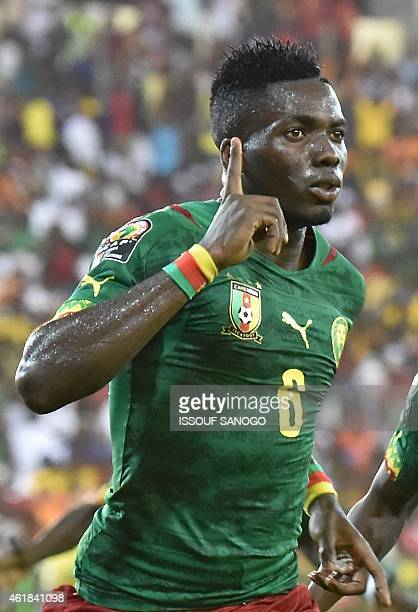 Cameroon's defender Ambroise Oyongo celebrates after scoring a goal during the 2015 African Cup of Nations group D football match between Mali and...