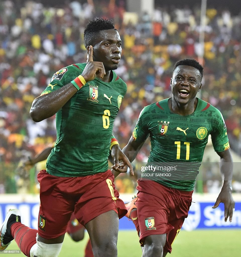 Cameroon's defender Ambroise Oyongo (L) celebrates with Cameroon's midfielder Edgar Salli after scoring a goal during the 2015 African Cup of Nations group D football match between Mali and Cameroon in Malabo on January 20, 2015.