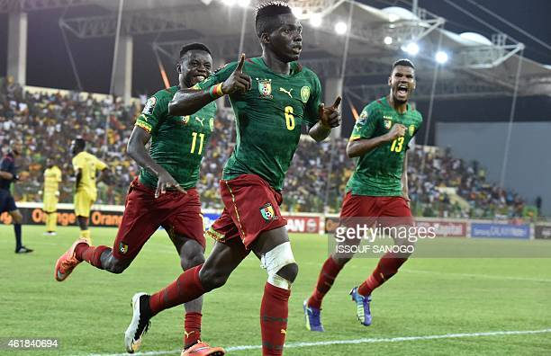 Cameroon's defender Ambroise Oyongo celebrates with teammates after scoring a goal during the 2015 African Cup of Nations group D football match...