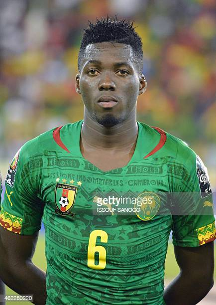 Cameroon's defender Ambroise Oyongo poses ahead of the 2015 African Cup of Nations group D football match between Cameroon and Guinea in Malabo on...