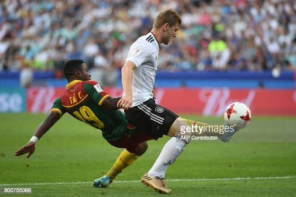 Cameroon's defender Collins Fai challenges Germany's forward Timo Werner during the 2017 FIFA Confederations Cup group B football match between...