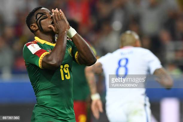 TOPSHOT Cameroon's defender Collins Fai reacts after Chile scored during the 2017 Confederations Cup group B football match between Cameroon and...