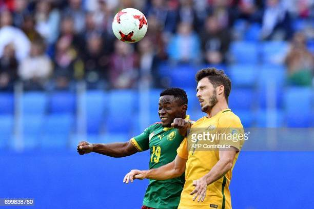 TOPSHOT Cameroon's defender Collins Fai vies for the ball against Australia's forward Mathew Leckie during the 2017 Confederations Cup group B...
