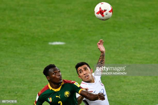 Cameroon's defender Ernest Mabouka challenges Chile's forward Edson Puch during the 2017 Confederations Cup group B football match between Cameroon...