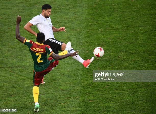 Cameroon's defender Ernest Mabouka challenges Germany's midfielder Emre Can during the 2017 FIFA Confederations Cup group B football match between...