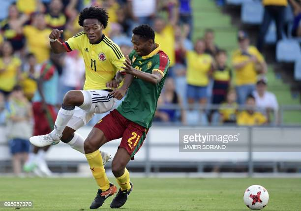 Cameroon's defender Lucien Owona vies with Colombia's midfielder Juan Cuadrado during the friendly football match Cameroon vs Colombia at the Col...