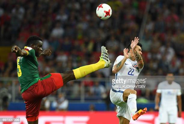 Cameroon's defender Michael NgadeuNgadjui challenges Chile's forward Edson Puch during the 2017 Confederations Cup group B football match between...