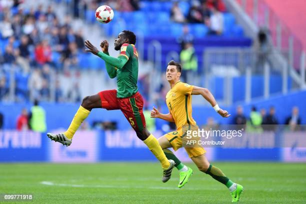 Cameroon's defender Michael NgadeuNgadjui vies for the ball against Australia's forward Tomi Juric during the 2017 Confederations Cup group B...