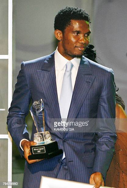 Cameroon's football player Samuel Eto'o poses with his trophy 01 February 2008 during the Confederation of African Football Awards 2007 ceremony...