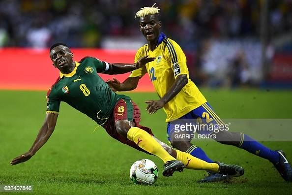 TOPSHOT Cameroon's forward Benjamin Moukandjo challenges Gabon's midfielder Didier Ibrahim Ndong during the 2017 Africa Cup of Nations group A...