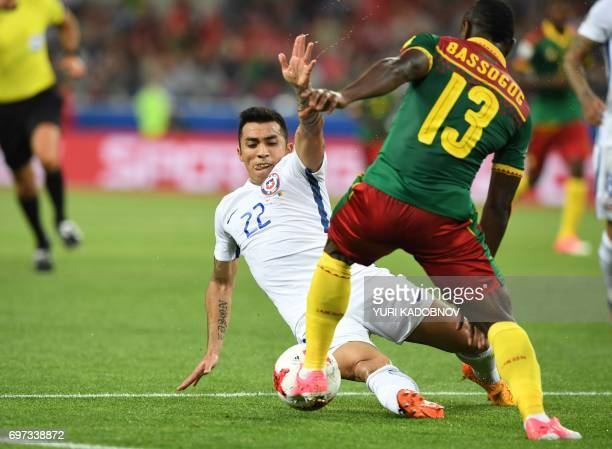 TOPSHOT Cameroon's forward Christian Bassogog challenges Chile's forward Edson Puch during the 2017 Confederations Cup group B football match between...