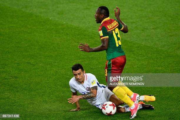 Cameroon's forward Christian Bassogog challenges Chile's forward Edson Puch during the 2017 Confederations Cup group B football match between...