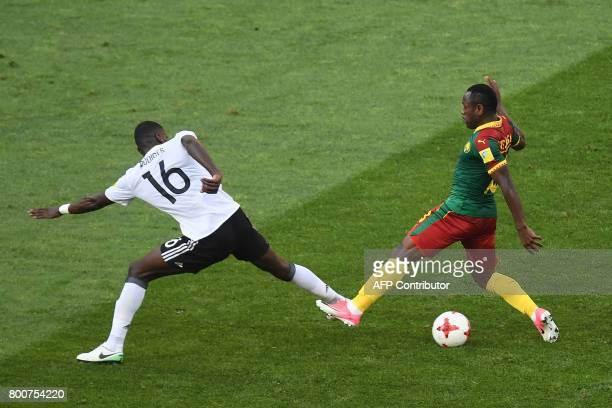 Cameroon's forward Christian Bassogog challenges Germany's defender Antonio Ruediger during the 2017 FIFA Confederations Cup group B football match...
