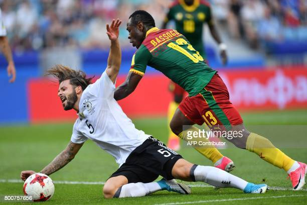 Cameroon's forward Christian Bassogog challenges Germany's defender Marvin Plattenhardt during the 2017 FIFA Confederations Cup group B football...