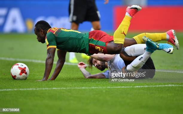 Cameroon's forward Christian Bassogog falls over Germany's defender Marvin Plattenhardt during the 2017 FIFA Confederations Cup group B football...