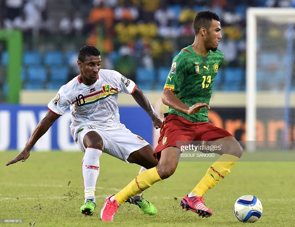 Cameroon's forward Eric Choupo Moting (R) challenges Guinea's midfielder <a gi-track='captionPersonalityLinkClicked' href=/galleries/search?phrase=Kevin+Constant&family=editorial&specificpeople=3033289 ng-click='$event.stopPropagation()'>Kevin Constant</a> during the 2015 African Cup of Nations group D football match between Cameroon and Guinea in Malabo on January 24, 2015.