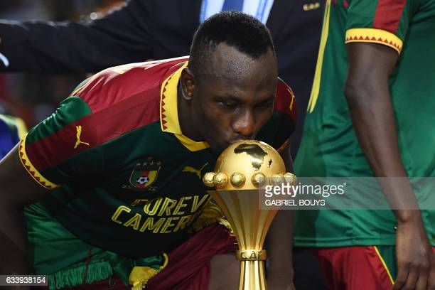 Cameroon's forward Jacques Zoua kisses the winner's trophy after Cameroon beat Egypt 21 in the 2017 Africa Cup of Nations final football match...