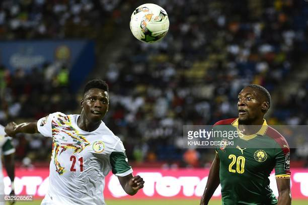 Cameroon's forward Karl Toko Ekambi challenges Senegal's defender Lamine Gassama during the 2017 Africa Cup of Nations quarterfinal football match...