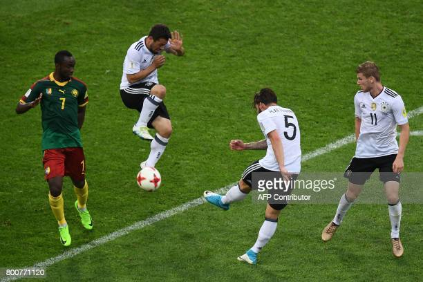 Cameroon's forward Nicolas Ngamaleu challenges Germany's midfielder Amin Younes Germany's defender Marvin Plattenhardt and Germany's forward Timo...