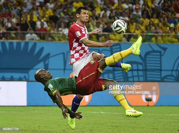 Cameroon's forward Pierre Webo vies for the ball with Croatia's defender Dejan Lovren during a Group A football match between Cameroon and Croatia in...