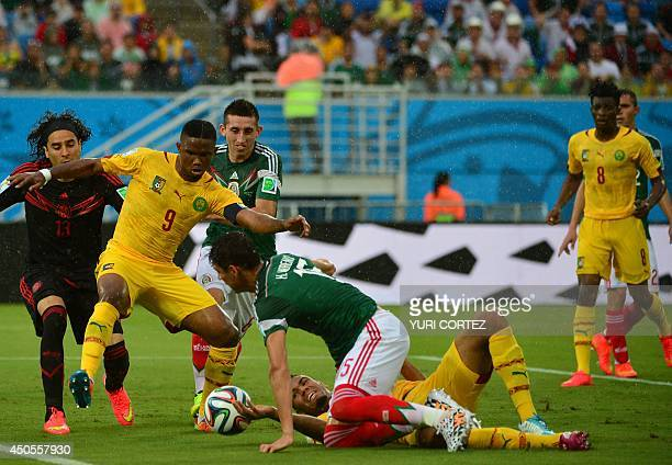 Cameroon's forward Samuel Eto'o challenges Mexico's midfielder Hector Herrera and defender Hector Moreno during the Group A football match between...