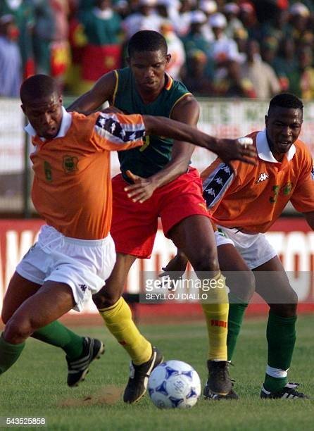 Cameroon's forward Samuel Eto'o Fils fights for the ball with Ivory Coast's Mamadou Coulibaly and Ibrahima Kone during their group C match for the...