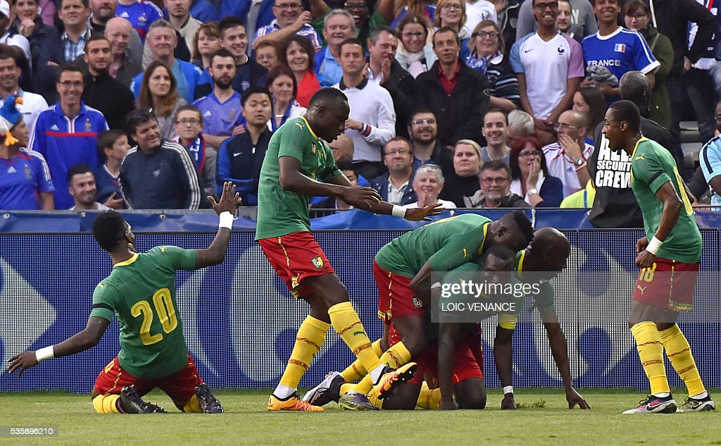 Cameroon's forward Vincent Aboubakar (3rd R) celebrates with his teammates after scoring a goal during the International friendly football match between France and Cameroon at the Beaujoire stadium, in Nantes, western France, on May 30, 2016 as part of the French team's preparation for the upcoming Euro 2016 European football championships. / AFP / LOIC