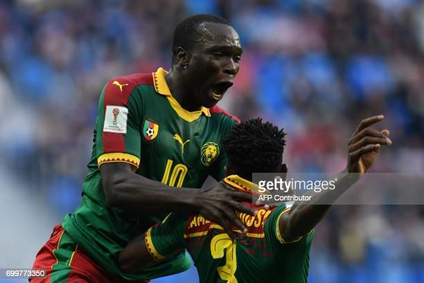 TOPSHOT Cameroon's forward Vincent Aboubakar congratulates Cameroon's midfielder Andre Zambo after he scored the match's first goal during the 2017...