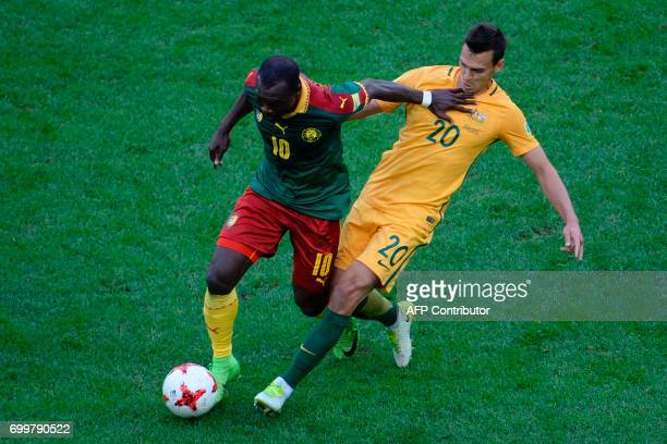 Cameroon's forward Vincent Aboubakar fights for the ball against Australia's defender Trent Sainsbury during the 2017 Confederations Cup group B...