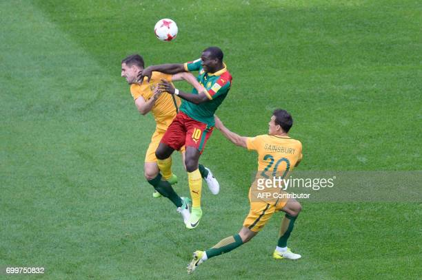 TOPSHOT Cameroon's forward Vincent Aboubakar jumps for the ball against Australia's defender Milos Degenek during the 2017 Confederations Cup group B...
