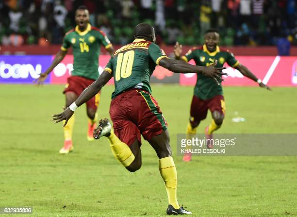 Cameroon's forward Vincent Aboubakar runs to celebrate after scoring the winning goal during the penalty shootout at the end of the 2017 Africa Cup...