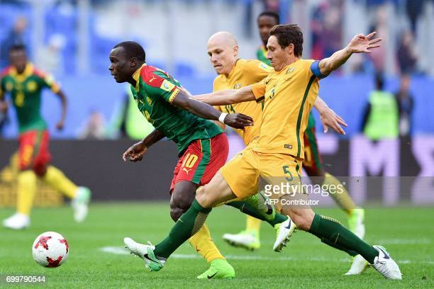 Cameroon's forward Vincent Aboubakar vies for the ball against Australia's midfielder Mark Milligan during the 2017 Confederations Cup group B...