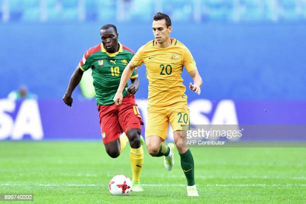 Cameroon's forward Vincent Aboubakar vies for the ball against Australia's defender Trent Sainsbury during the 2017 Confederations Cup group B...